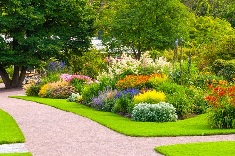 A colorful garden with walkways and trees