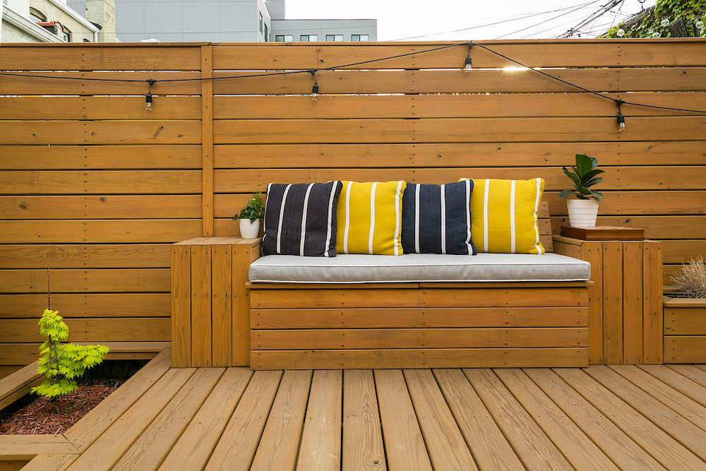Image of a remodeled backyard with built-in bench seat