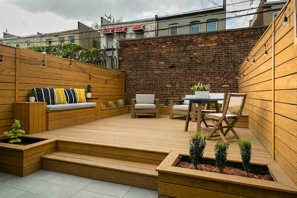 Image of a remodeled backyard with tiered seating area