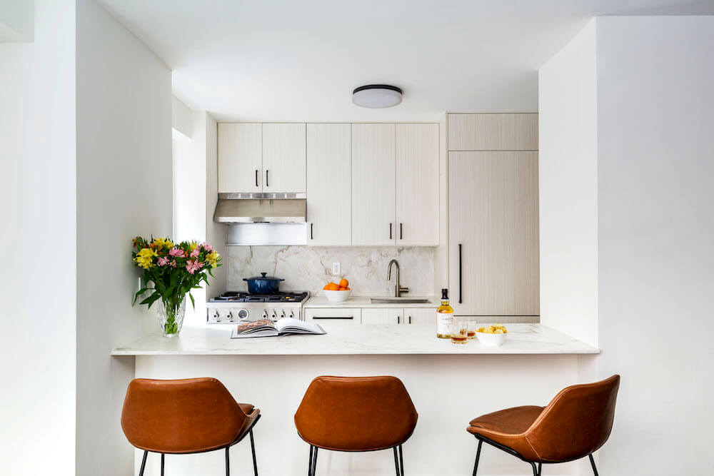 Image of a renovated kitchen with Calacatta marble backsplash