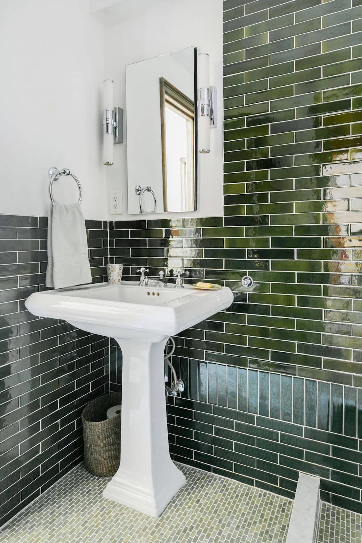 Image of green subway tile and pedestal sink