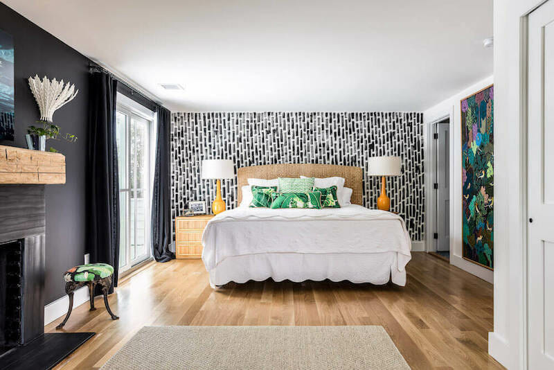 master bedroom with black and white painted mural behind bed