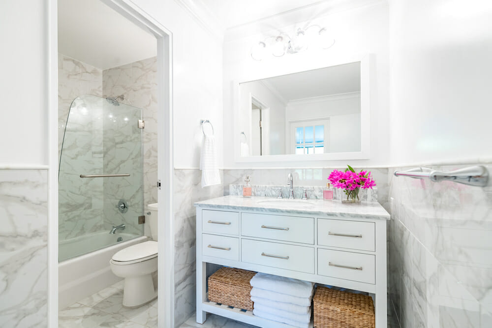 Image of a renovated bathroom with Calacatta marble walls