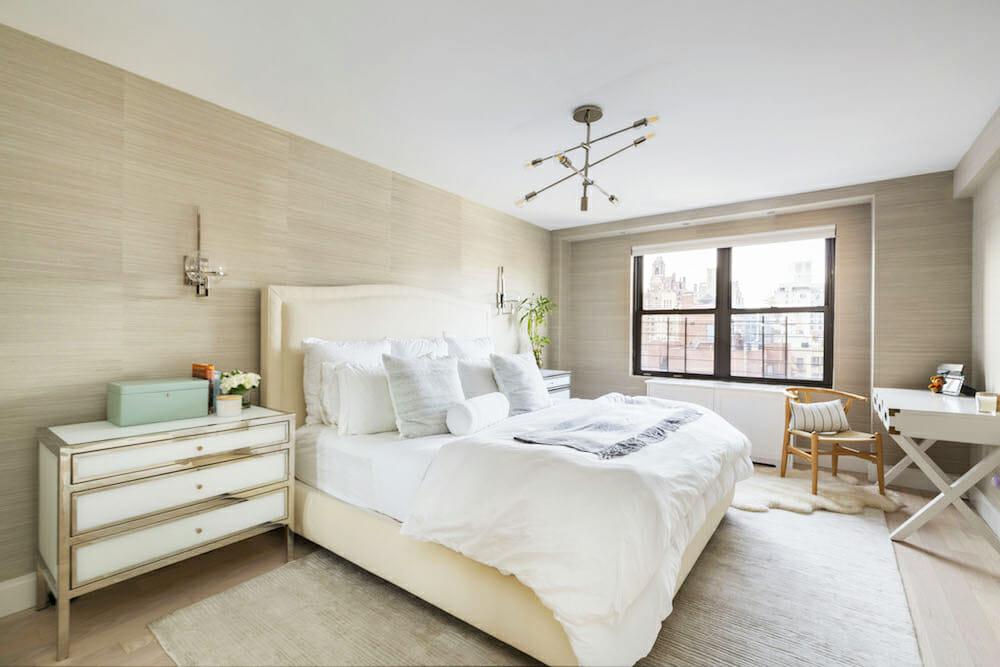 master bedroom with textured tan hemp wallpaper