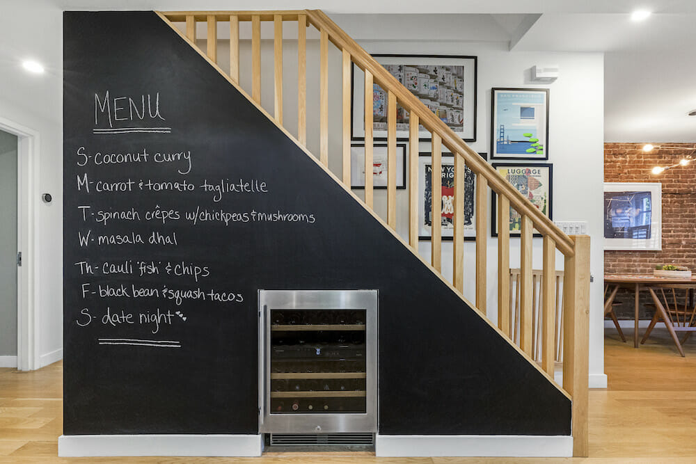 Image of a wine fridge under the stairs