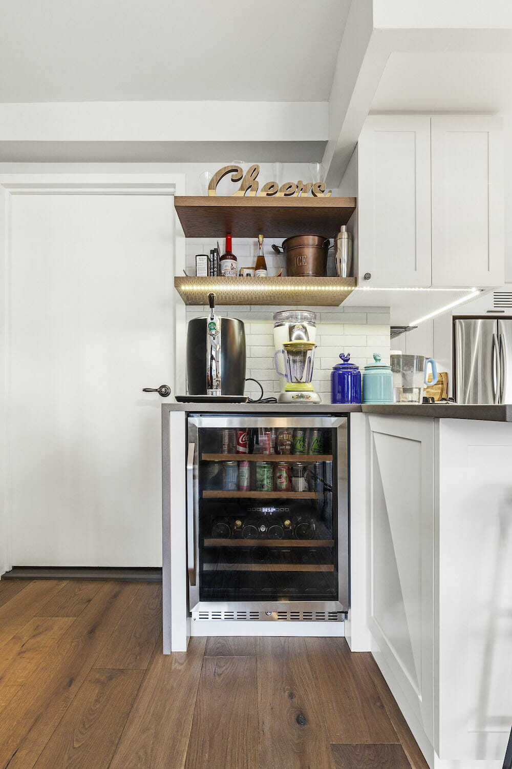 Image of a small wine fridge in kitchen nook