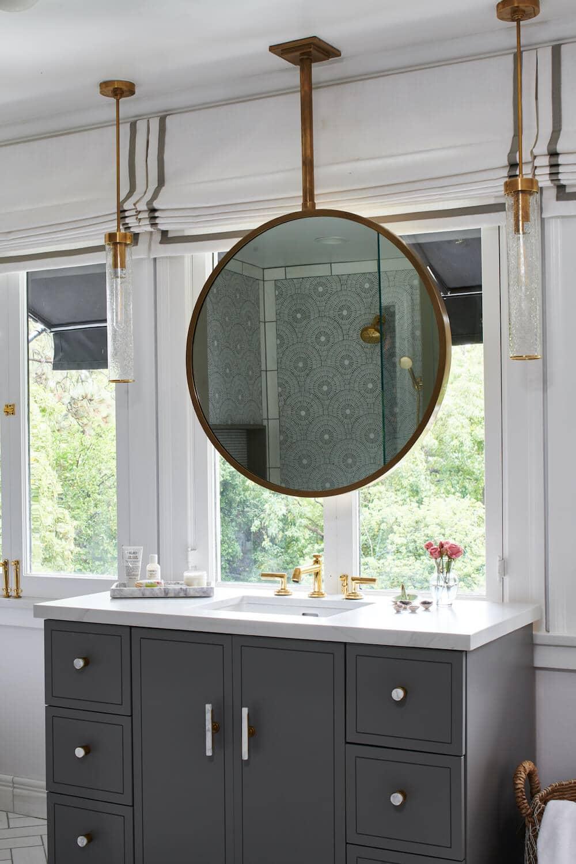 Bathroom with modern bronze hanging vanity mirror