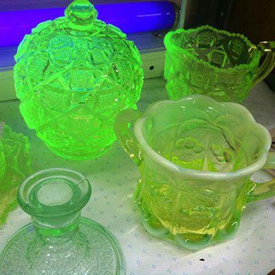 Glowing green drinking glasses containing uranium.