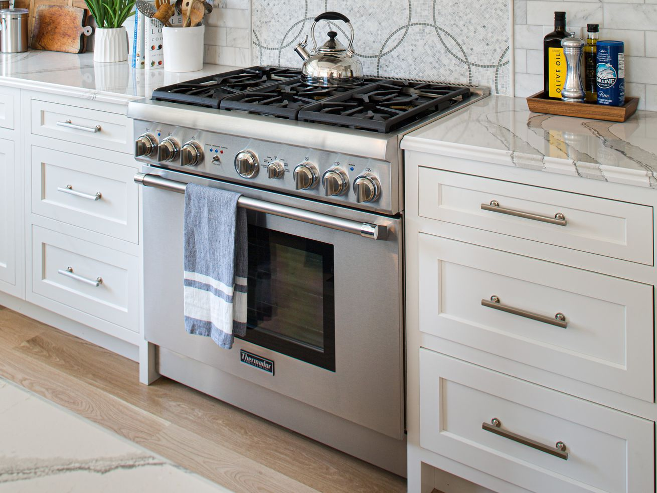 A gas oven in a modern kitchen.